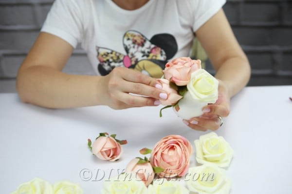 Continue gluing the flowers onto the Styrofoam ball until you have covered it completely.