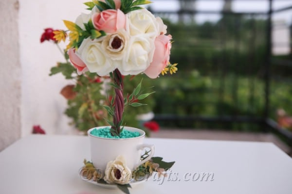 Your topiary tree flower arrangement is stunning.