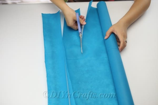 Cut long strips of fabric or paper.