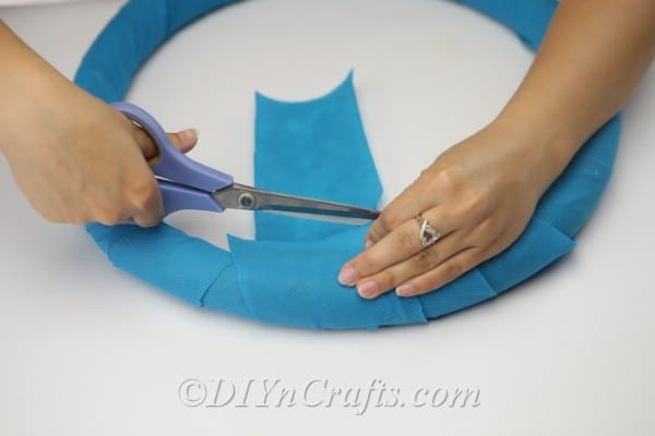 Cut away any excess fabric or paper when you are done and glue down what is left.