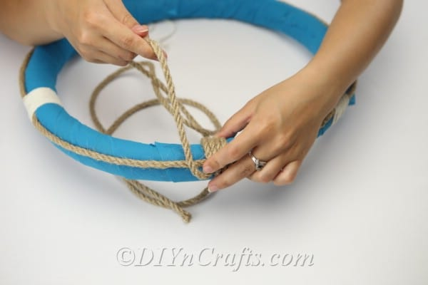 Wrap rope around and around the top of the wreath