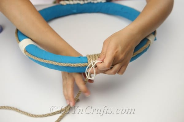 Keep wrapping rope around the top of the wreath.