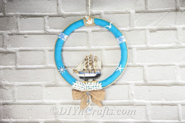 A nautical DIY wreath hanging against a wall.