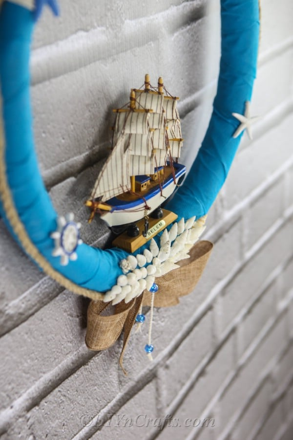 A close-up of a nautical-themed wreath hanging against the wall.