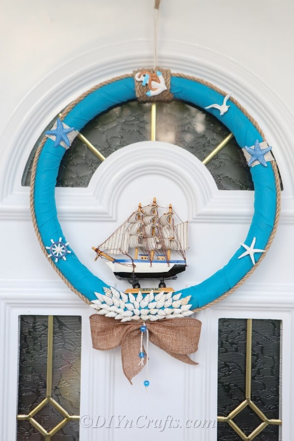 A nautical DIY wreath hanging on a door.