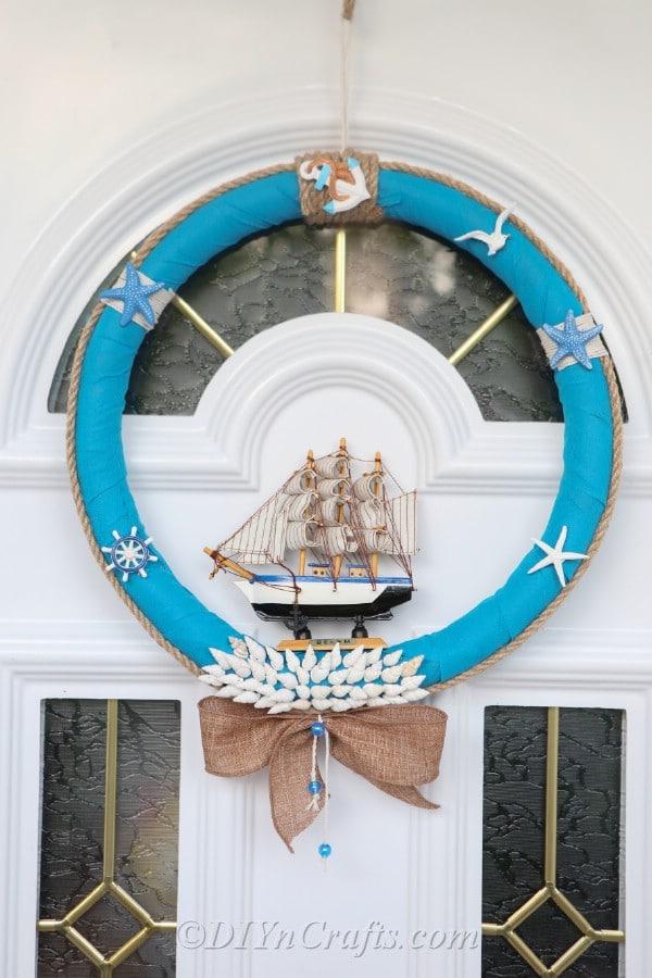 A nautical DIY wreath hanging on a door.