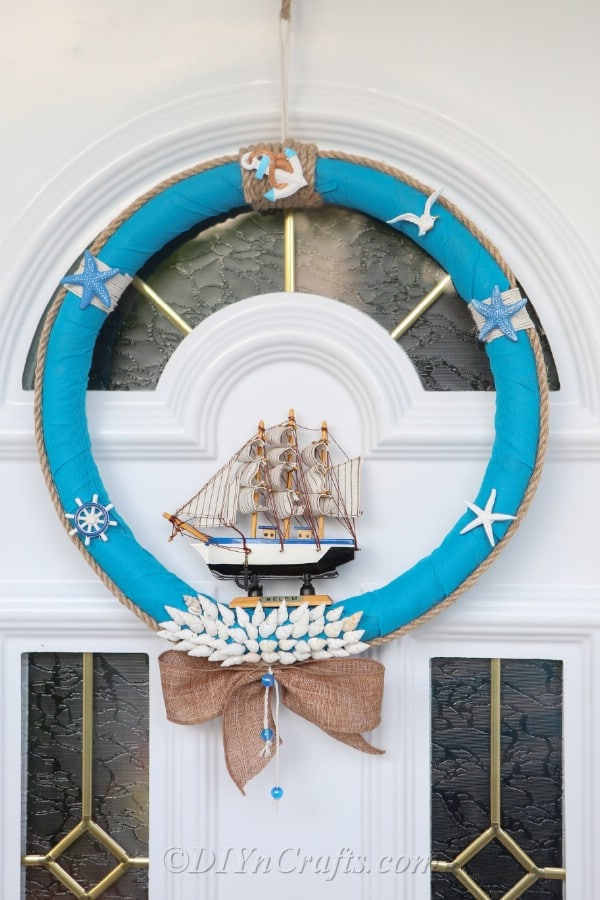 A closer view of a nautical DIY wreath hanging on a door.