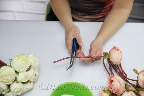 Use pliers to cut the flower stems.