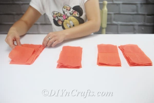 Split your strips of tissue paper into four piles