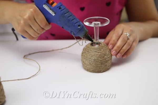 Continue wrapping twine around your glass.
