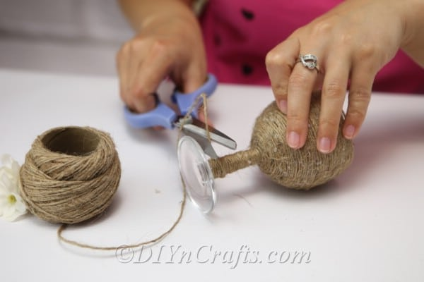 Cut the twine when you reach the base of the wine glass.