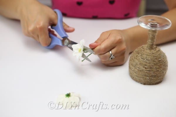 Cut faux flowers to attach to your candle holder.