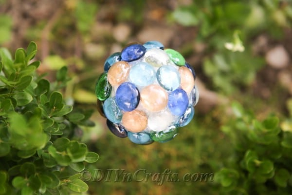 A DIY ball lawn ornament close up.