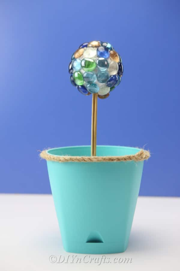 A DIY ball decoration in a planter.