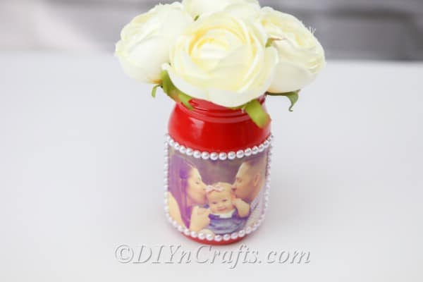 A DIY jar vase with flowers in it
