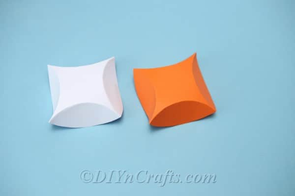 Folded cardstock pieces ready to create a gift box