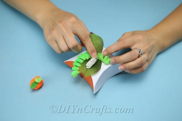 Gluing pipe cleaners to the top of diy gift box