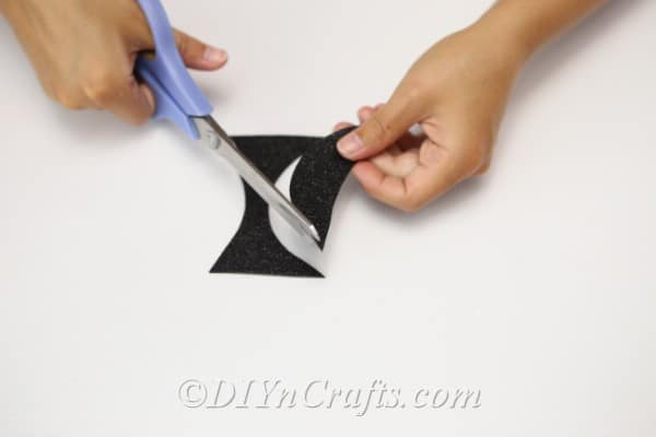 Cutting the mouth out of black foam