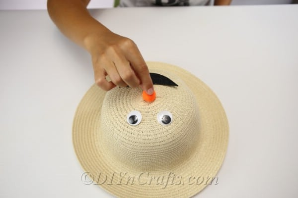 Adding a face to your straw hat scarecrow