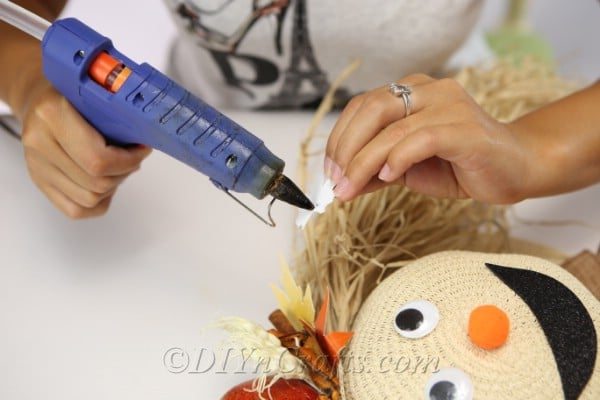 Adding decorations to your scarecrow harvest decor