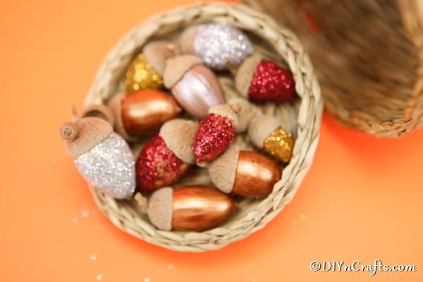 Up close picture of completed harvest craft glitter acorns