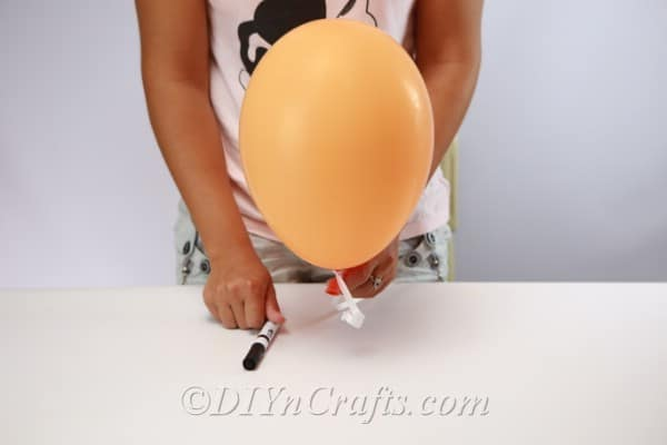 A single halloween balloon being readied for decoration
