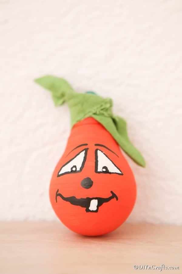 Painted orange pumpkin decorative light bulbs idea