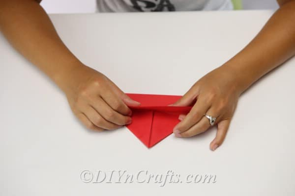 Folding paper to create a hat for scarecrow craft