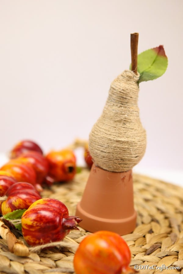 A completed twine wrapped lightbulb pear fruit decoration