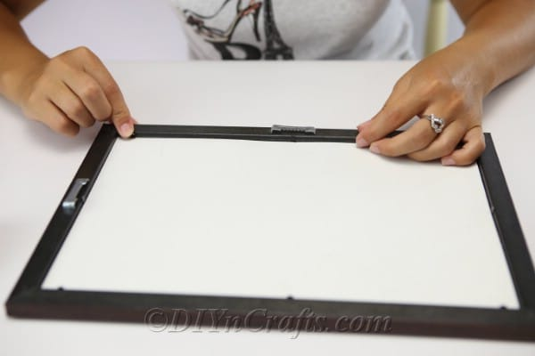 Removing back of picture frame to create button art
