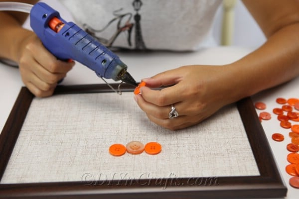 Creating the outline of the pumpkin for the button wall art craft