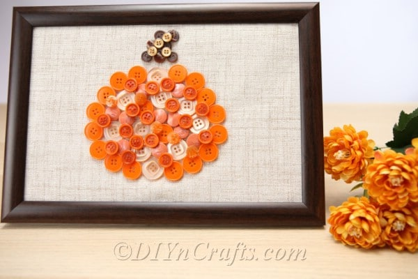 Pumpkin button art displayed on a countertop