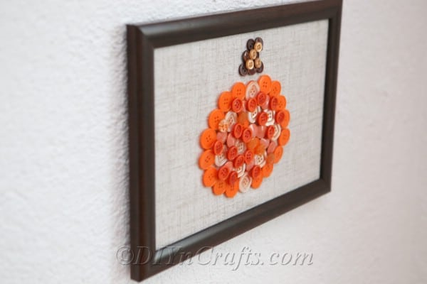 Picture of hanging pumpkin button art wall piece from the side