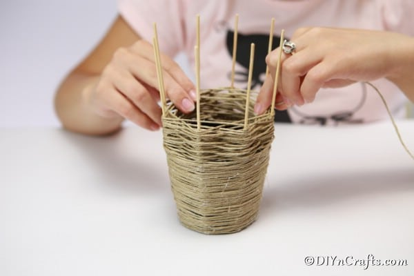 Wrapping the thread around the dowels for the woven basket