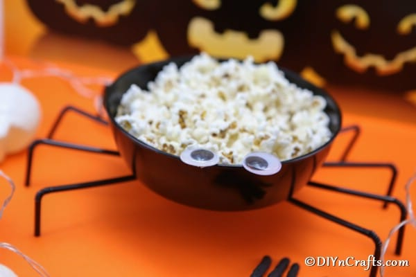 Up close picture of spider bowl filled with popcorn