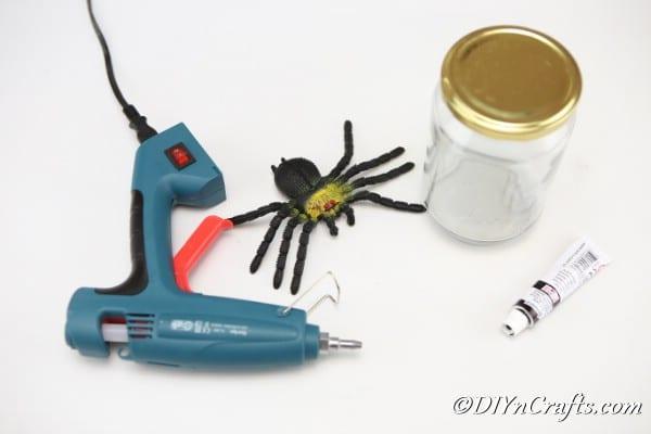 Supplies for a halloween spider jar craft