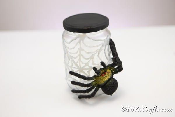 Completed halloween spider web craft jar