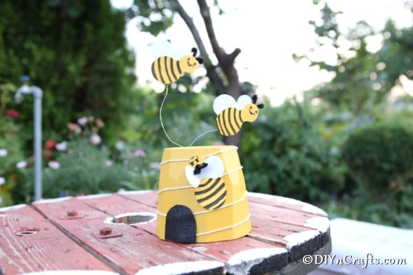 A garden bee decoration on a wooden table
