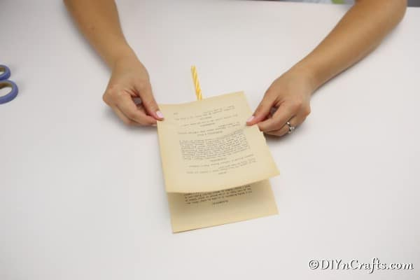 Gluing the pages of a book together for a decorative feathers project