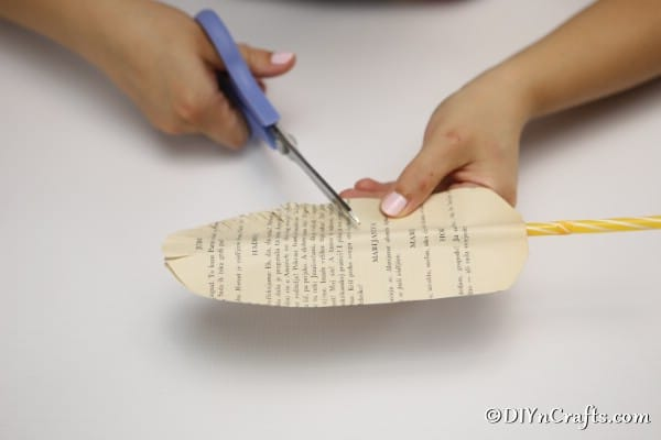 Cutting the paper into a feather shape