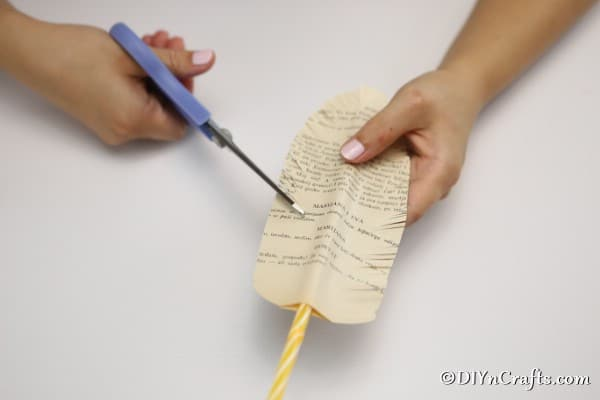 Cutting small feather fringe on old paper decorative feathers