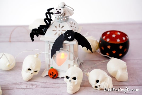 Fun magnets for Halloween on a white counter with plastic skulls and lanterns