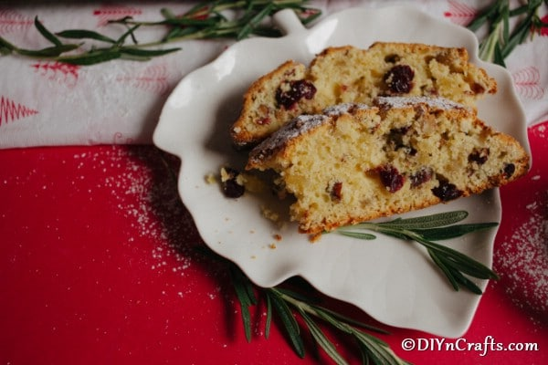 Slices of Christmas stollen on a white plate