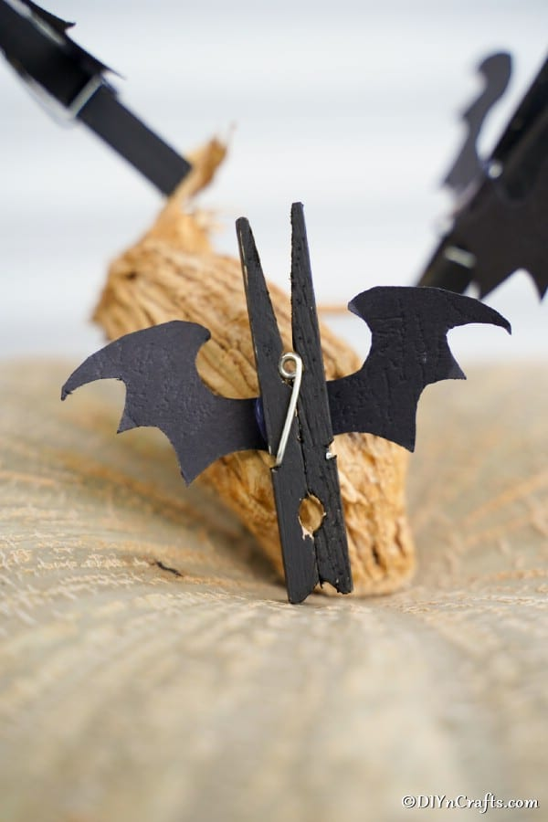A completed halloween bat clothespin on a pumpkin