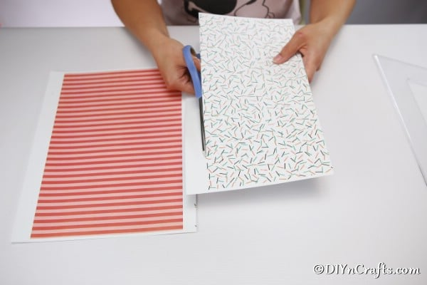 Cutting paper to create a fairy house