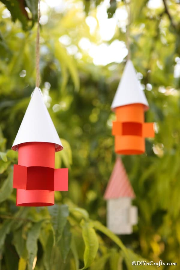 Fairy and gnome houses hanging in a tree