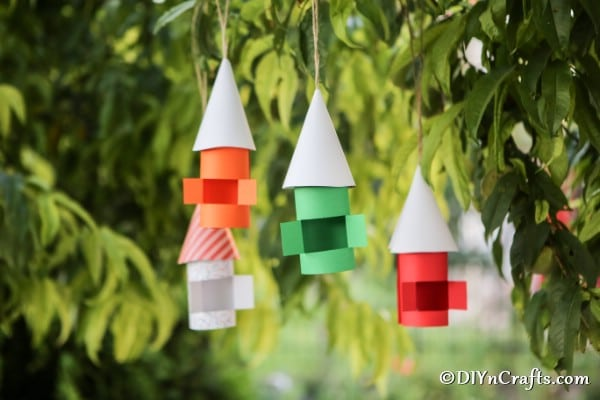A set of paper gnome houses in a tree
