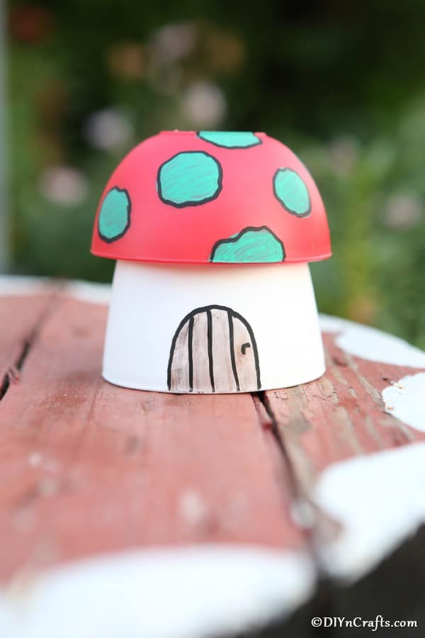 A single painted mushroom planter garden decoration on a picnic table