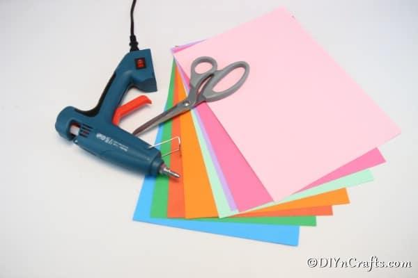 Supplies for making a paper fan garland decoration