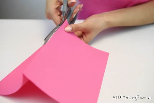Folding and cutting paper for a fan garland